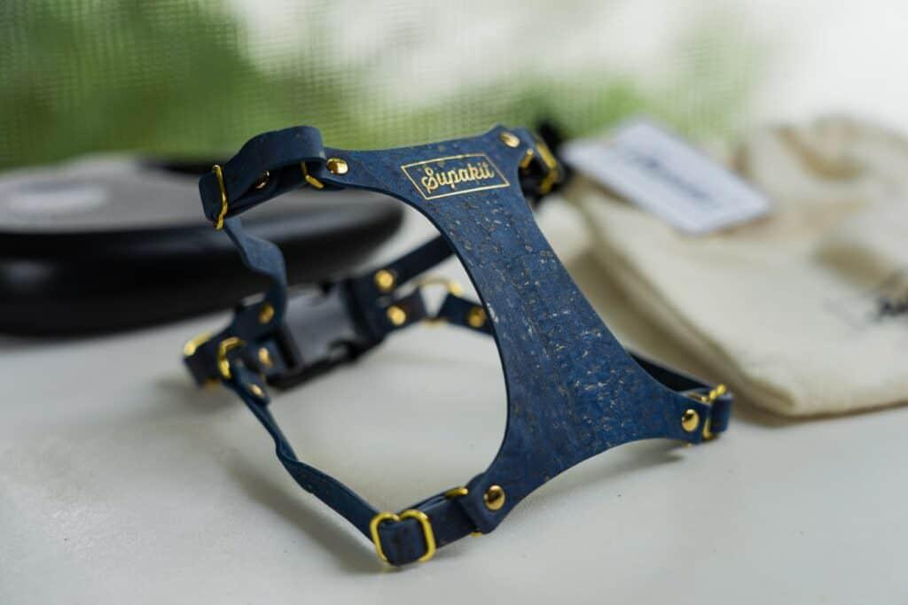 blue vegan cork supakit harness on table with cat leash