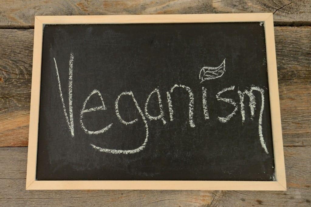 black chalk board with veganism written on it